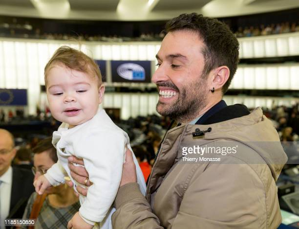 Portugese Member of the European Parliament Francisco Guerreiro with his daughter in his arms attend a session of the European Parliament on November...