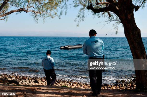 Portugese officers serving for the European Border and Coast Guard Agency look at a rubber boat from a recent refugee arrival during their patrol in...