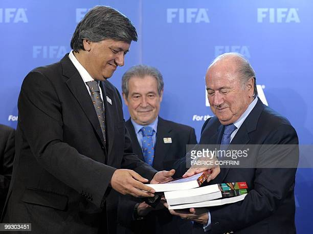 Portugese sport minister Laurentino Dias delivers to FIFA president Sepp Blatter the Spanish/Portugese FIFA World Cup bid book in front of general...