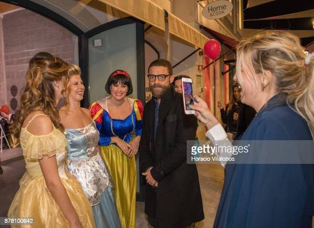 Portuguese actor Diogo Amaral poses for a picture by actress Jessica Athaide with special fantasy characters outside Kids' lounge during the Designer...