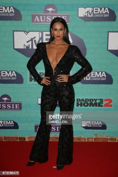 Portuguese actress Rita Pereira poses on the red carpet arriving to attend the 2017 MTV Europe Music Awards at Wembley Arena in London on November 12...