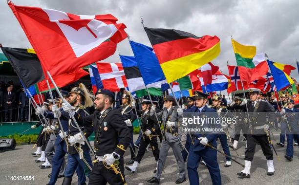 Portuguese Armed Forces personnel parade with NATO member flags before Portuguese President Marcelo Rebelo de Sousa during a ceremony staged by the...