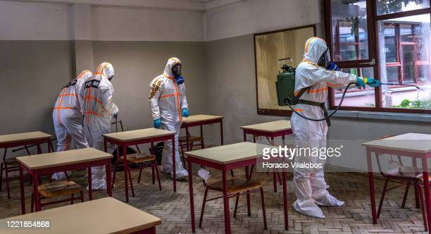 Portuguese Army personnel wear protective gear at a demonstration of classroom disinfection in the Amadora High School during the COVID19 Coronavirus...