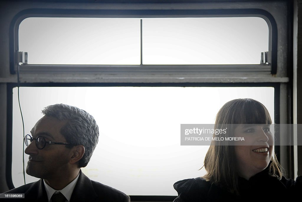 Portuguese artist Joana Vasconcelos (R) and Secretary of State for Culture Jorge Barreto Xavier attend a press conference during the official presentation of an old boat from Lisbon, called 'Cacelheiro', that will be the platform to the future Portugal pavilion that will represent the country at the next Venice Biennale, in Seixal, near Lisbon, on February 12, 2013.