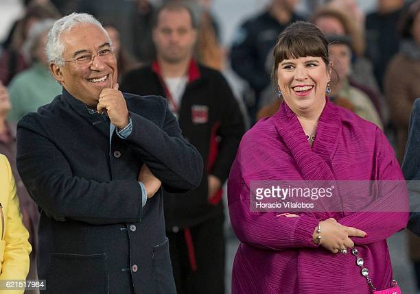 Portuguese artist Joana Vasconcelos is accompanied by Portugal's Prime Minister Antonio Costa during the inauguration of Pop Galo her public art work...