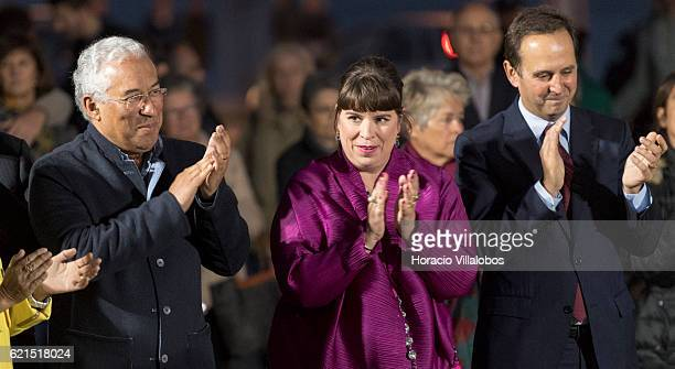 Portuguese artist Joana Vasconcelos is accompanied by Portugal's Prime Minister Antonio Costa and Lisbon Mayor Fernando Medina during the...