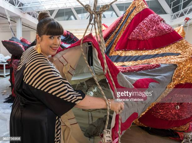 Portuguese artist Joana Vasconcelos poses before Valkyrie main part of her solo exhibition I'm Your Mirror at the Guggenheim Museum Bilbao Spain in...