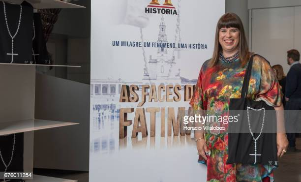 Portuguese artist Joana Vasconcelos poses in front of the documentary poster while showing rosary bags during a press conference with Managing...