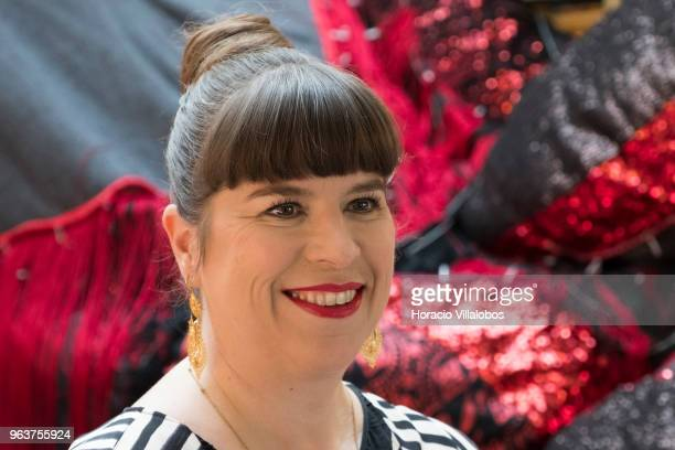 Portuguese artist Joana Vasconcelos smiles before Valkyrie main part of her solo exhibition I'm Your Mirror at the Guggenheim Museum Bilbao Spain in...