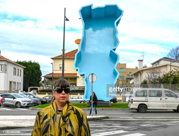 Portuguese artist Joana Vasconcelos talks to journalists in front of one of her works during a guided visit for the press of her major solo...