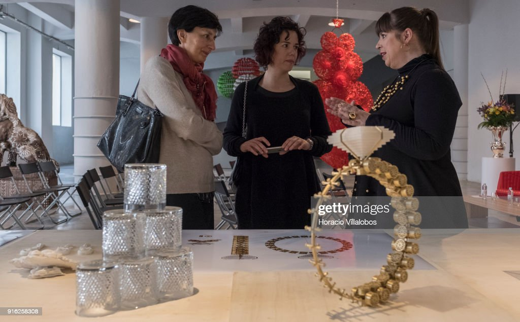 Portuguese artist Joana Vasconcelos (R) talks to journalists in front of scale models of some of her works during the press conference announcing her solo exhibition in the Guggenheim Museum Bilbao, Spain, with the presence of the curators and museum representatives, at the artist's atelier on February 09, 2018 in Lisbon, Portugal. Joana Vasconcelos: 'I'm Your Mirror' is curated by Petra Joos and Enrique Juncosa and is the first solo exhibition of a Portuguese artist in a Guggenheim Museum. It includes some of the most iconic works from 1997 to today, as well as new works and a site-specific installation.