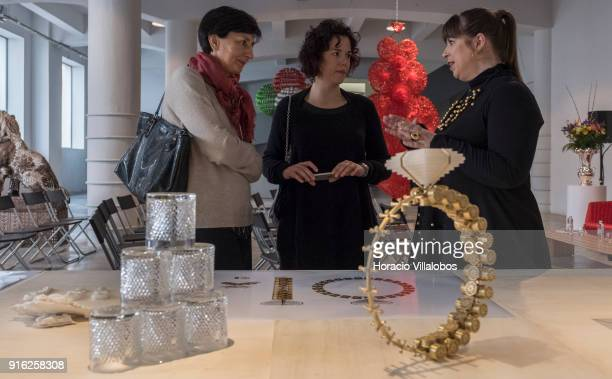 Portuguese artist Joana Vasconcelos talks to journalists in front of scale models of some of her works during the press conference announcing her...
