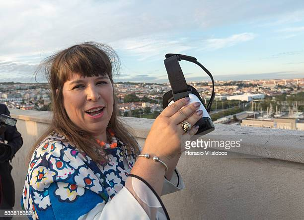 Portuguese artist Joana Vasconcelos tries virtual reality goggles at the top of the Padrao dos Descobrimentos during the public presentation of...