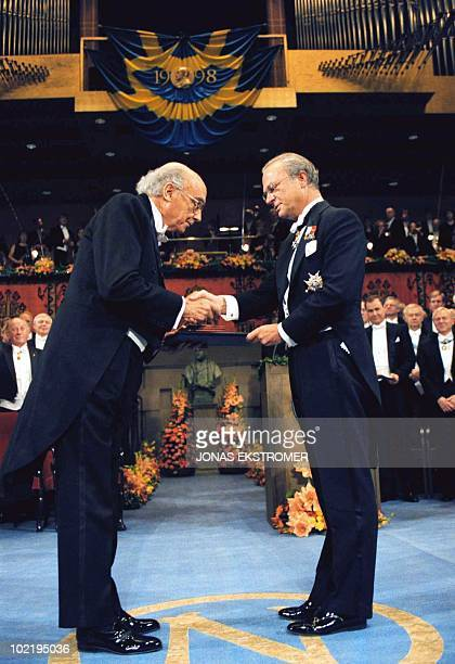 Portuguese author Jose Saramago receives the Nobel Prize for Literature from Swedish King Carl XVI Gustaf at the Concert Hall in Stockholm, Sweden,...