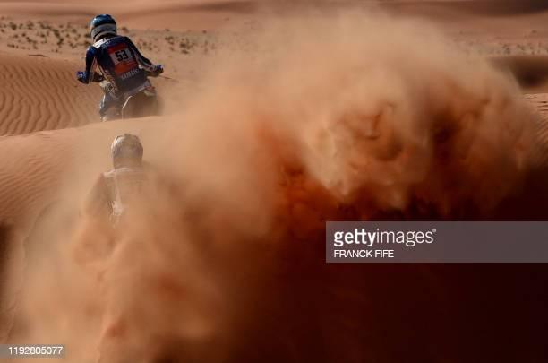 TOPSHOT Portuguese biker Antonio Mao and Honda's Chilean biker Jose Ignacio Florimo Cornejo compete during the Stage 6 of the Dakar 2020 between...