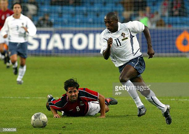 Portuguese Boa Morte runs for the ball in front of Norwegian opponent Martin Andresen in the first half of their friendly match at Ullevaal Stadium...
