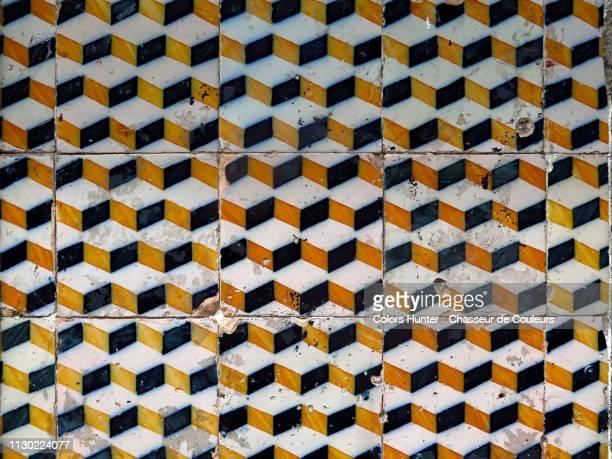 portuguese ceramics azulejos on a wall - portugiesische kultur stock-fotos und bilder
