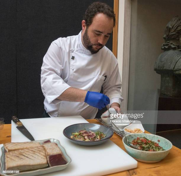 Portuguese Chef Luis Rodrigues prepares Tuna tataki with peanuts kaffir lime and avocado a local dish included in Small Luxury Hotels of the World...