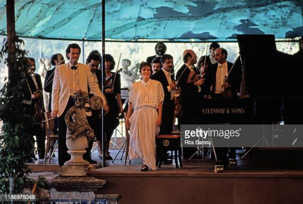 Portuguese Classical musician Maria Joao Pires with members of the Gulbenkian Orchestra takes a bow during a performance at the Sintra Music Festival...