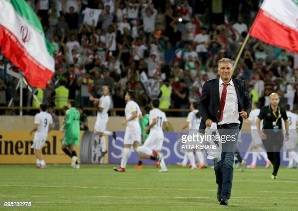 Portuguese coach Carlos Queiroz of the Iranian national football team smiles after winning the 2018 World Cup qualifying football match between Iran...