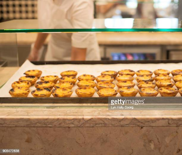 portuguese custard tarts ( pastel de nata) for sale in portuguese market - lyn holly coorg stock pictures, royalty-free photos & images