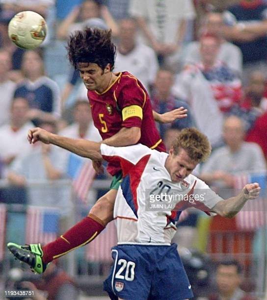 Portuguese defender Fernando Couto and US forward Brian McBride clash in their Group D match at the 2002 FIFA World Cup Korea/Japan in Suwon 05 June...