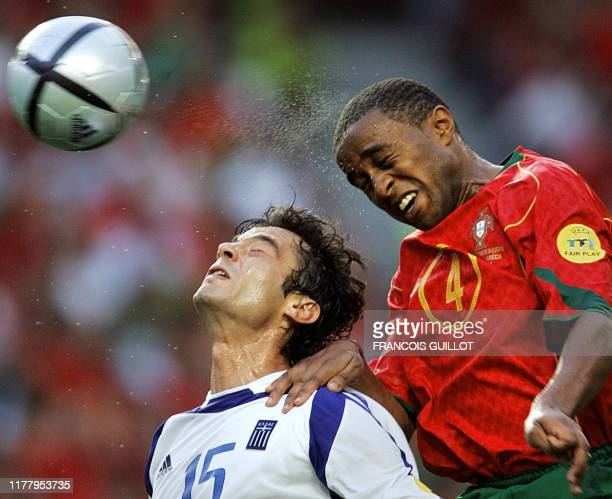 Portuguese defender Jorge Andrade vies with Greek forward Zisis Vryzas 04 July 2004 at the Luz stadium in Lisbon during the Euro 2004 final match...