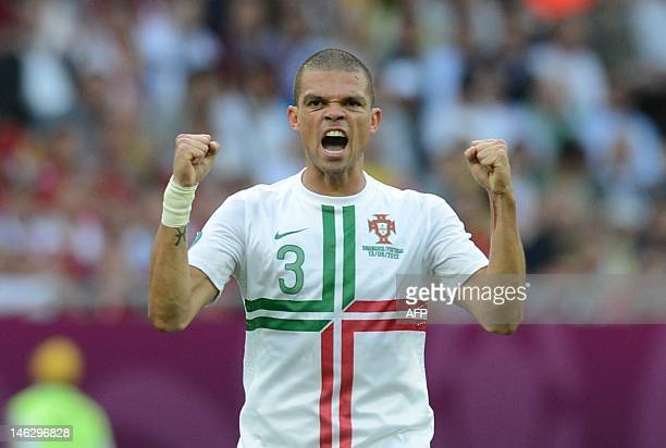 Portuguese defender Pepe celebrates after scoring a goal during the Euro 2012 championships football match Denmark vs Portugal on June 13 2012 at the...
