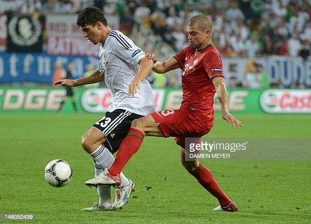 Portuguese defender Pepe vies with German forward Mario Gomez during the Euro 2012 championships football match Germany vs Portugal on June 9 2012 at...