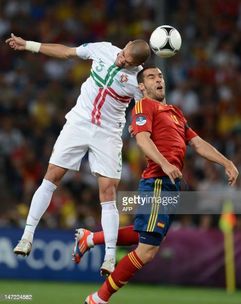Portuguese defender Pepe vies with Spanish forward Alvaro Negredo during the Euro 2012 football championships semifinal match Portugal vs Spain on...