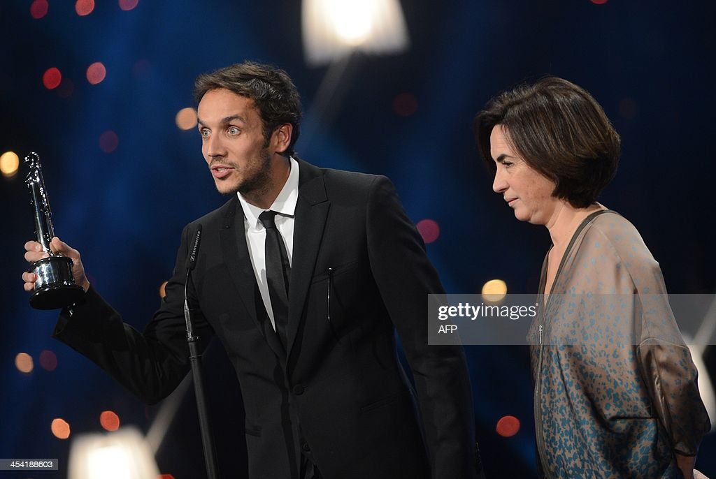 Portuguese director Ruben Alves receives his award from Portuguese actress Rita Blanco (R) at the 26th European Film Awards ceremony on December 7, 2013 in Berlin. Every year, the various activities of the European Film Academy culminate in the ceremony of the European Film Awards. In a total of 21 categories, among them European Film, European Director, European Actress and European Actor, the European Film Awards annually honour the greatest achievements in European cinema.