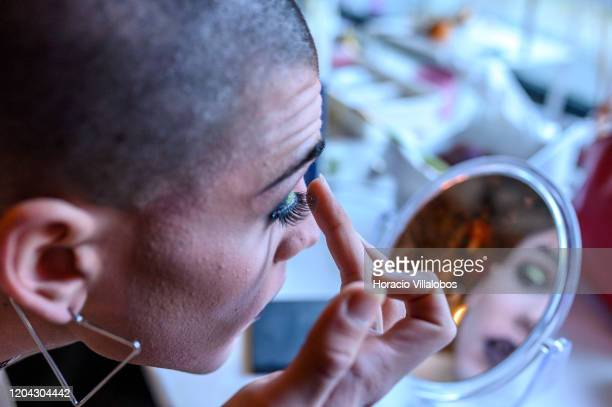 Portuguese Drag Queen performer Diogo Conde applies false eyelashes while getting ready to host a Drag Taste Cooking Class in LX Factory complex on...