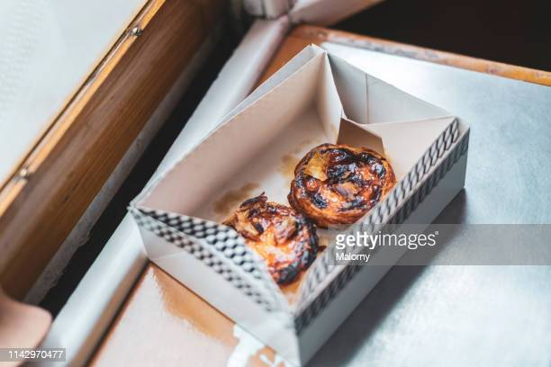 portuguese egg tarts in a box. pastel de nata - traditionally portuguese stock pictures, royalty-free photos & images
