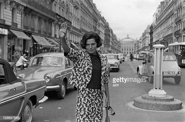 Portuguese fado singer Amalia Rodrigues gestures avenue de l'Opera on September 10 1964 in Paris Rodrigues' speciality was fado traditional...