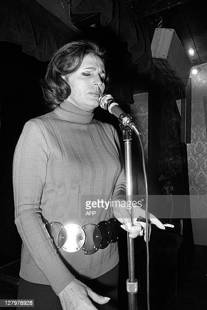 Portuguese fado singer Amalia Rodrigues performs on the stage of a cabaret on January 18 1972 in Paris Rodrigues' speciality was fado traditional...