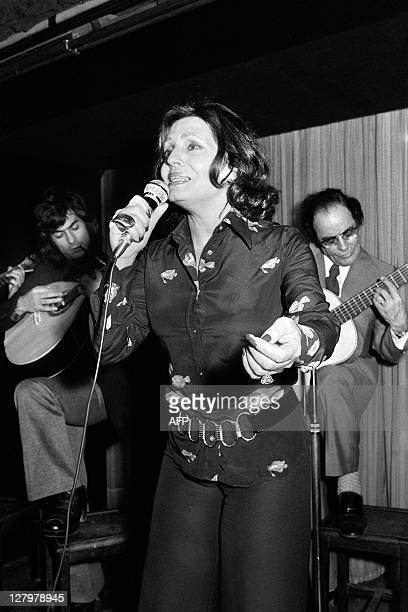 Portuguese fado singer Amalia Rodrigues performs on the stage of a cabaret on April 17 1973 in Paris Rodrigues' speciality was fado traditional...