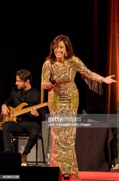 Portuguese Fado singer Ana Moura performs with her band with Andre Moreira on electric bass guitar at a World Music Institute concert at Town Hall...