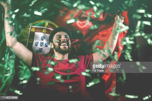 portuguese fan celebrating with the national flag - the championship football league stock pictures, royalty-free photos & images