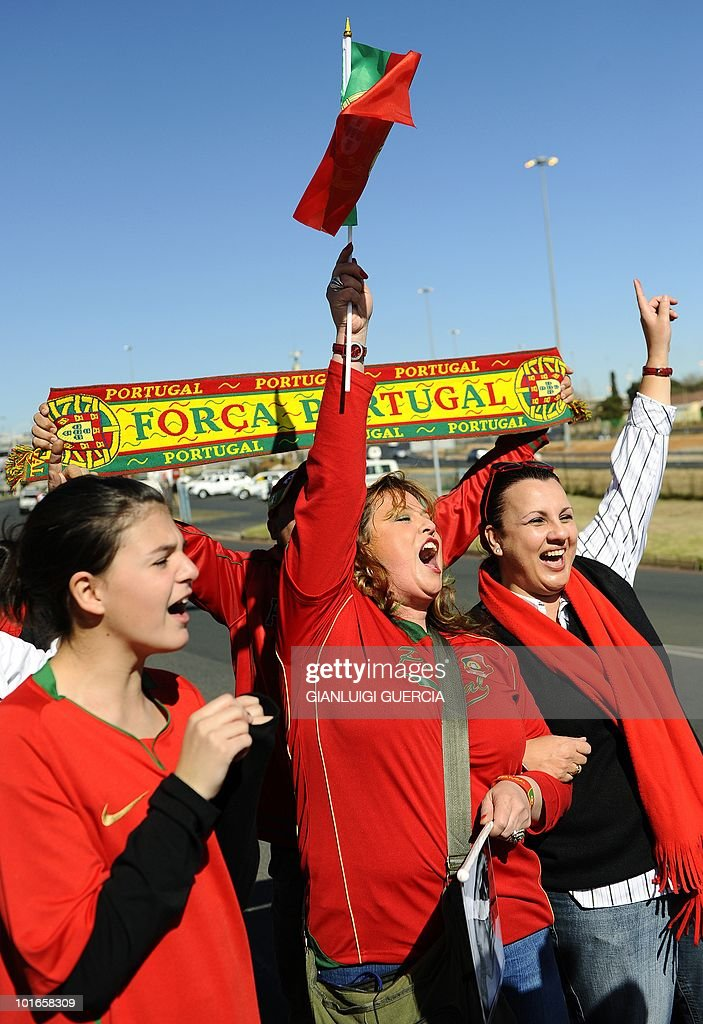 Portuguese fans cheer for their team after the arrival of Portugal's national football team at the O.R. Tambo international airport in Johannesburg on June 6, 2010 ahead of the 2010 World Cup football tournament.