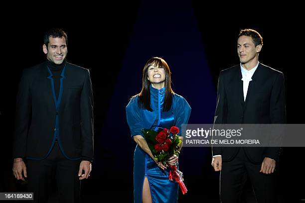Portuguese fashion designer Fatima Lopes flanked by Benfica's Brazilian goalkeeper Artur Moraes Benfica's Serbian midfielder Nemanja Matic...