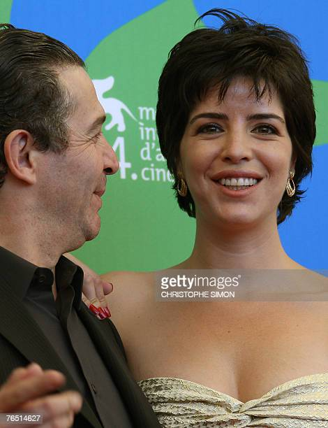 Portuguese film director Joao Canijo poses with Portuguese actress Anabela Moreira during a photocall of 'Mal Nascida' during the 64th Venice...