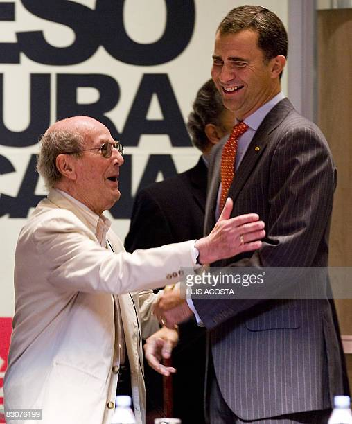 Portuguese film director Manoel de Oliveira jokes with Spanish Crown Prince Felipe de Borbon before before the opening of the First Congress on...