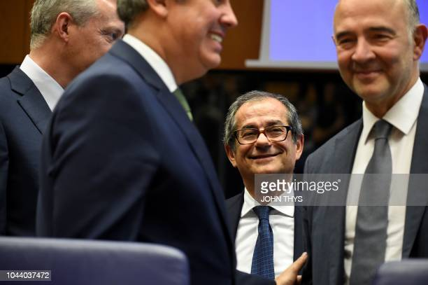 Portuguese Finance Minister and president of Eurogroup Mario Centeno and French Economy Finance Trade Minister Bruno Le Maire talk with Italian...