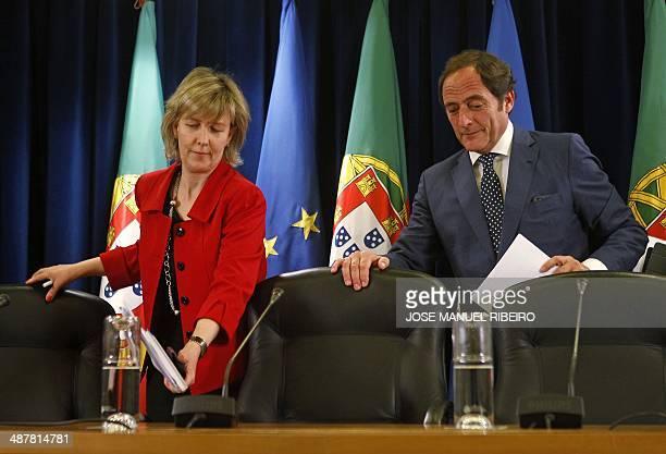 Portuguese Finance Minister Maria Luis Albuquerque and Portuguese Vice Prime Minister Paulo Portas take a seat prior the start of a press conference...