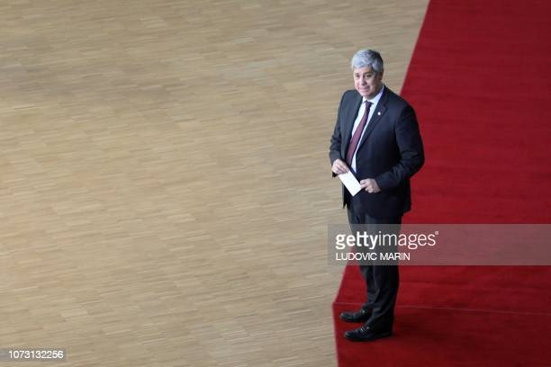 Portuguese Finance Minister Mario Centeno arrive on December 14 2018 in Brussels during the second day of a European Summit aimed at discussing the...
