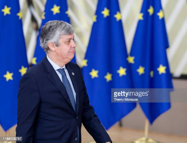 Portuguese Finance Minister, President of the group Mario Centeno arrives for the second of a two-day summit of European Union leaders on December...