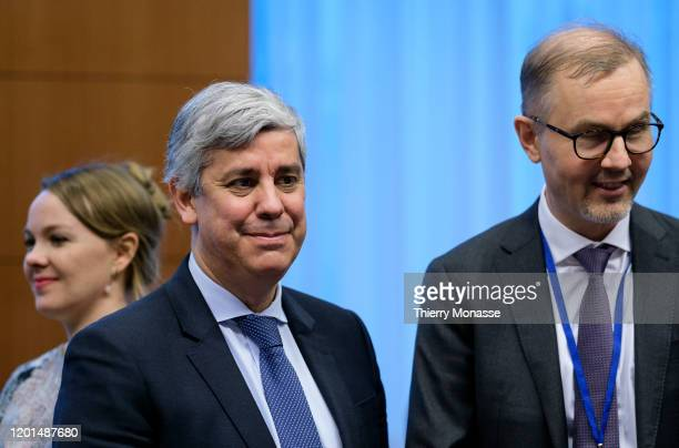 Portuguese Finance Minister, President of the group Mario Centeno is talking with the Finnish member of the Eurogroup Working Group Tuomas...