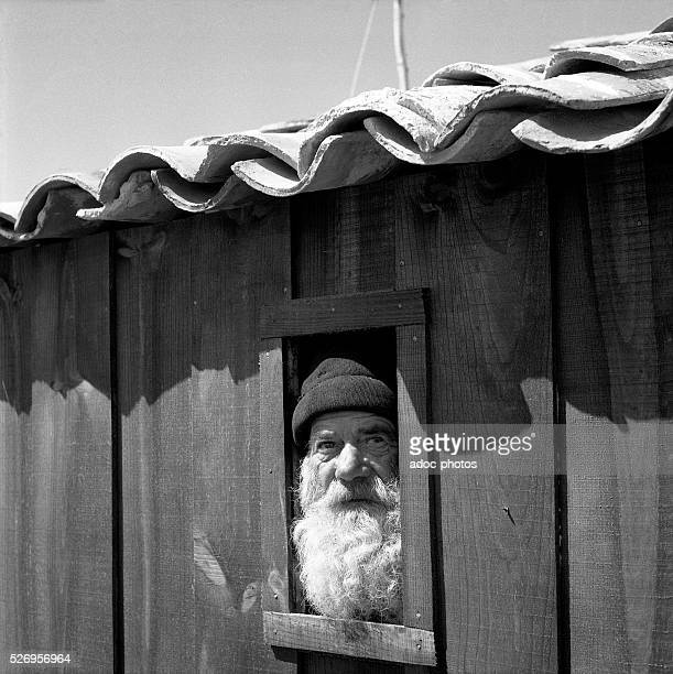 Portuguese fisherman in his hut In 1956