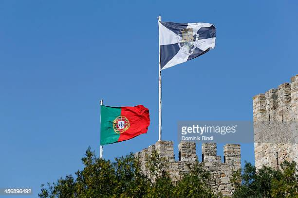 Portuguese Flag and Flag of Lisbon wave on top of Sao Jorge Castle on August 28 2014 in Lisbon Portugal
