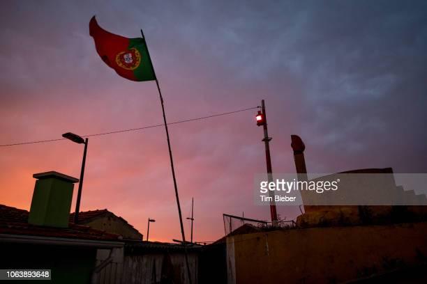 portuguese flag at sunset after a storm - bandeira de portugal imagens e fotografias de stock